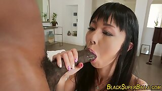 Black bull pumped a mountain of sperm into the sweet mouth of an oriental beauty.