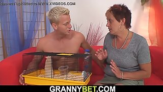 Younger dude drills her shaved old pussy