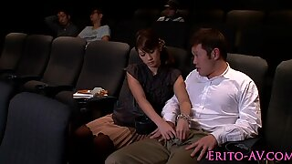 Japanese babe sucking cock in cinema