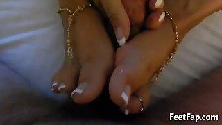 Sexy girl having fun giving foot-job