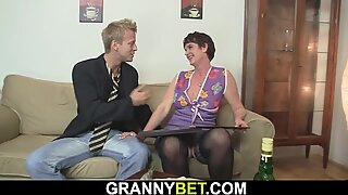 He pokes her unshaved senior pussy