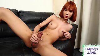Hot redheaded asian tgirl jerks off