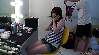 Young hottie gets ready in her dressing room