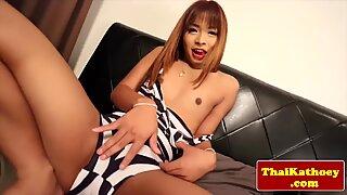 Young petite thai tgirl models her ass