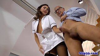 Sexy stockinged nurse climbs onto cock