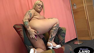 Curvy tgirl playing with her hard cock