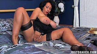 Busty black Milf masturbating