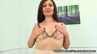 English milf Kitty Cream teases us with a slow striptease