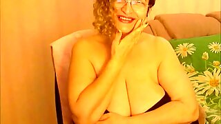 mature  sexy mom shows her big tits and suck herself