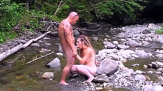 Whore fucked on the edge of a river
