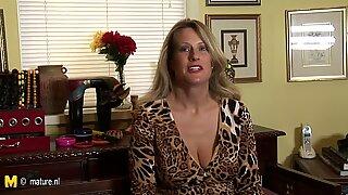 Hot American cougar mom masturbates while talking on phone