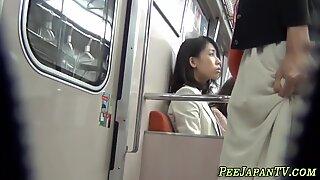 Asian amateur urinating